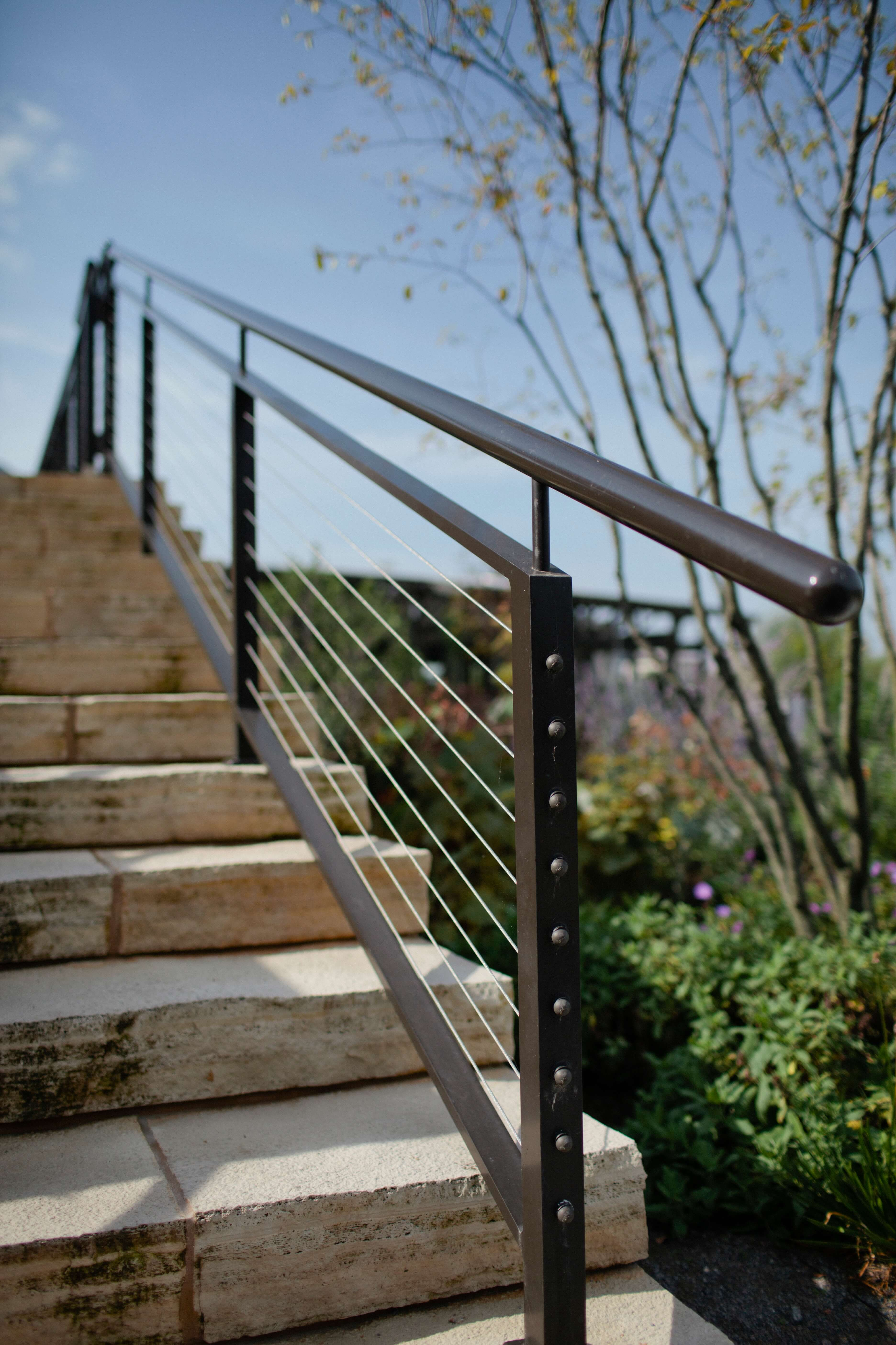 Modern stair rail artistic iron works for Modern outdoor railing